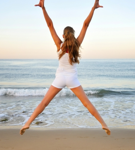 Healthy woman doing exercising on the beach, girl doing sport ou